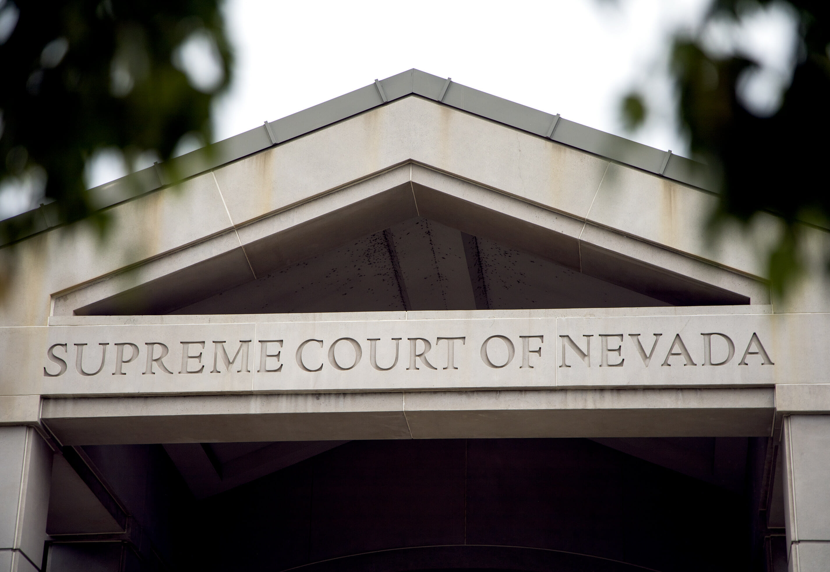 Photo of the top front of the building with the words Supreme Court of Nevada