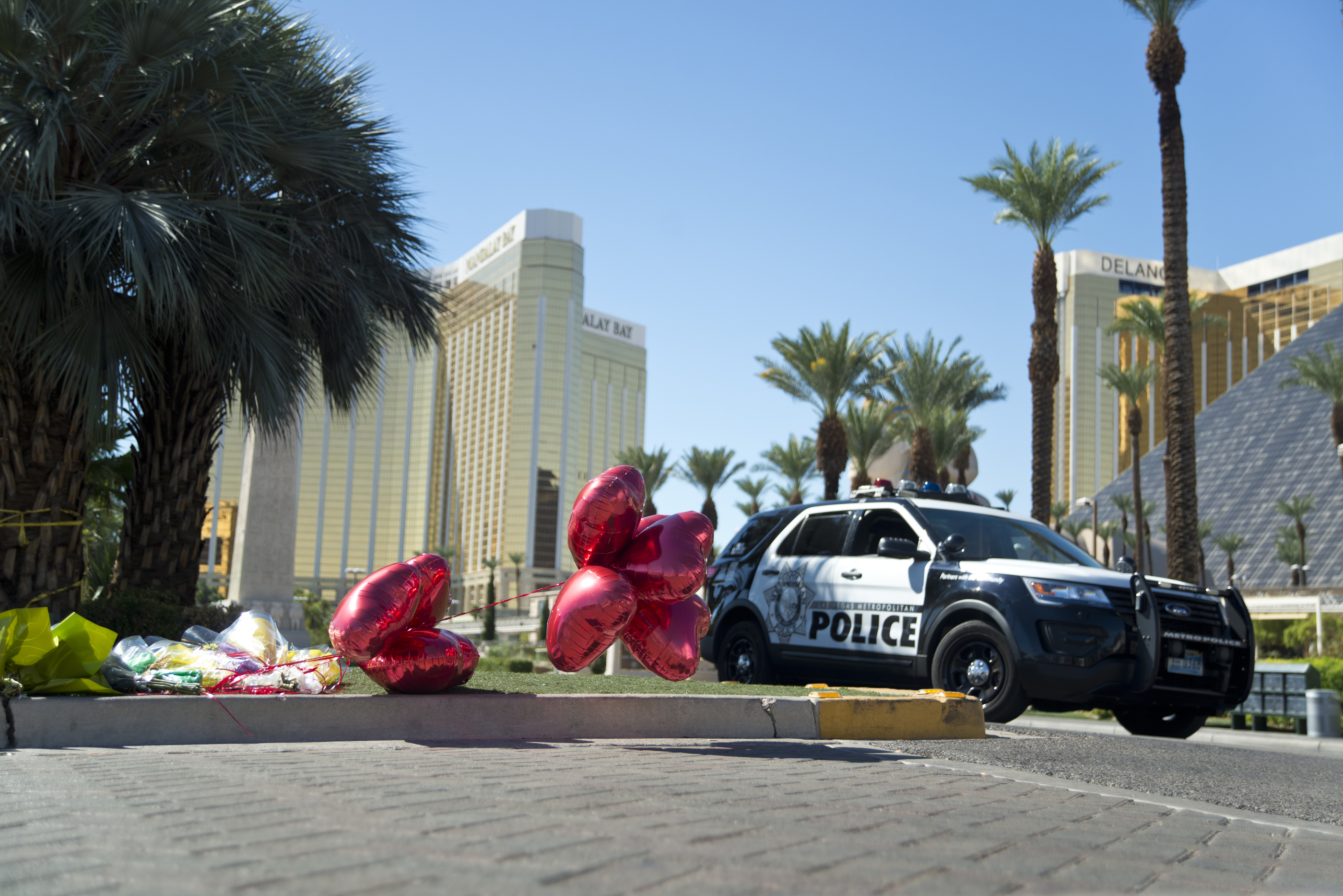 Flowers lay on the ground near the Route 91 Festival grounds