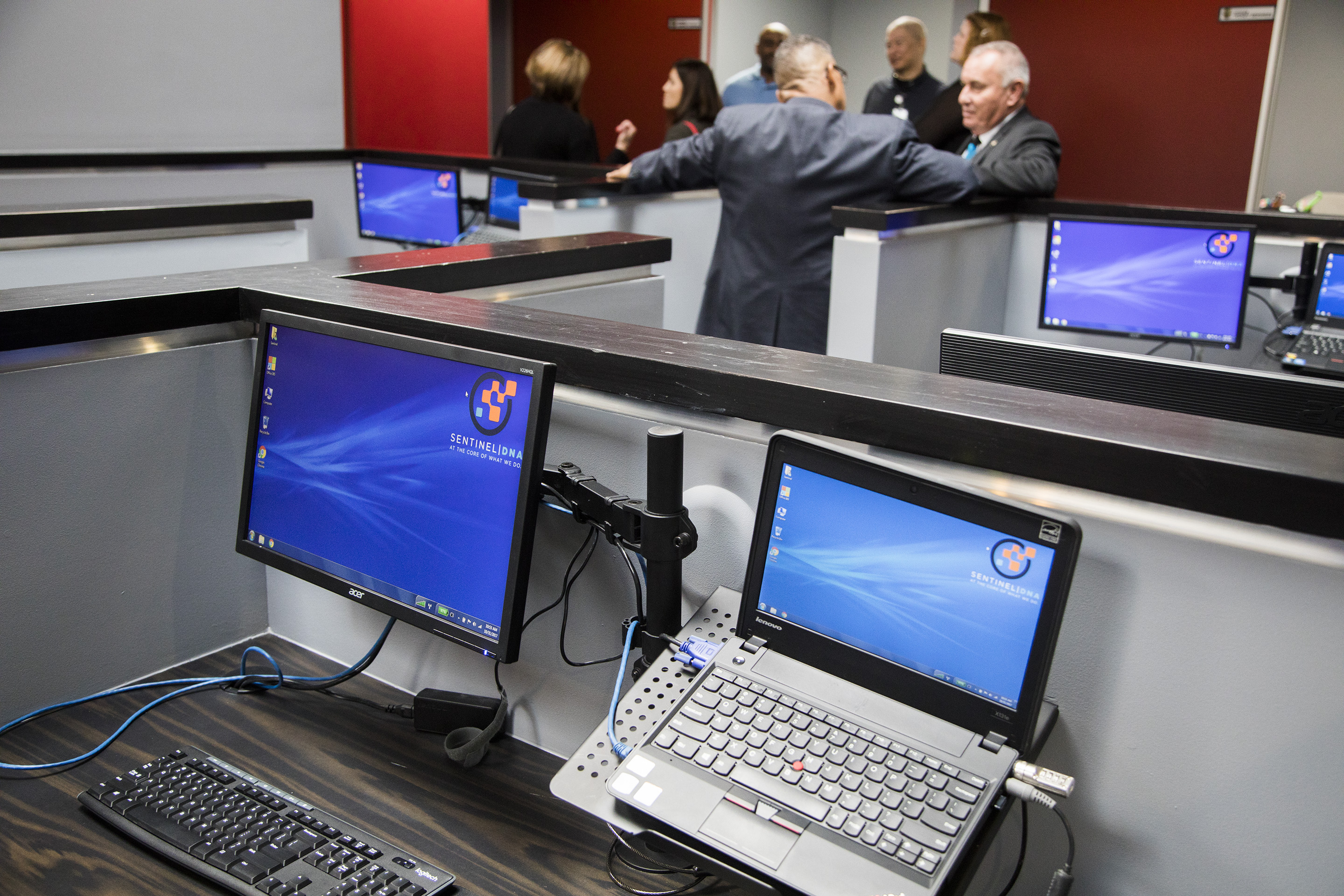Four computers in a computer room