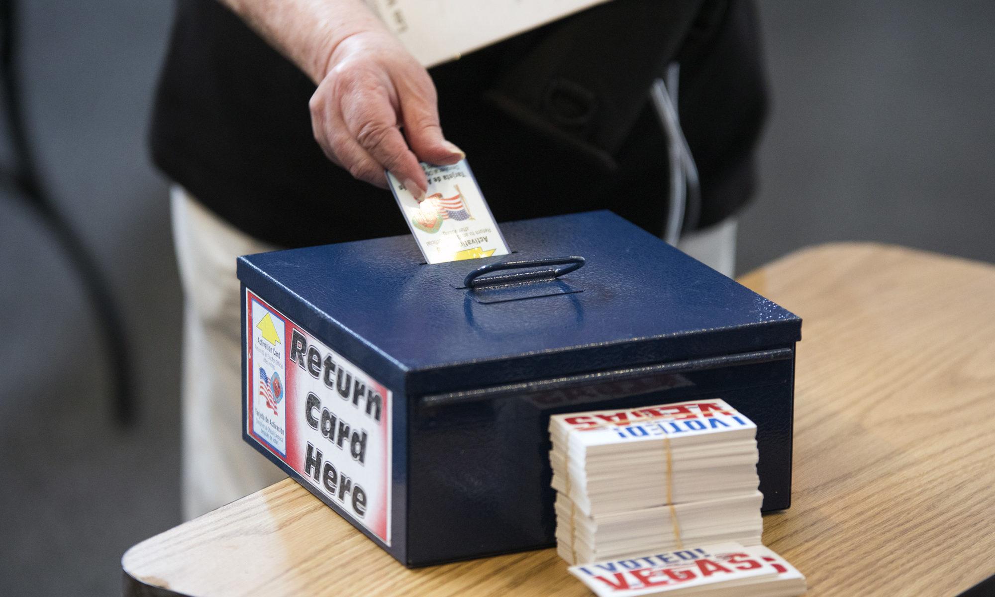 A women turns in her ballot