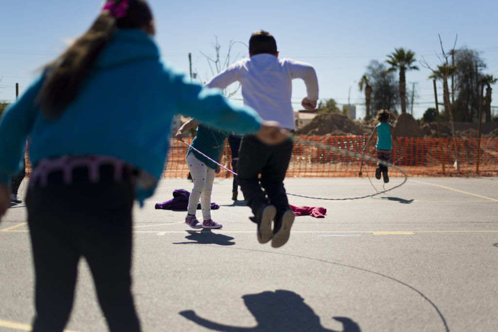 Children playing jump-rope on a playground