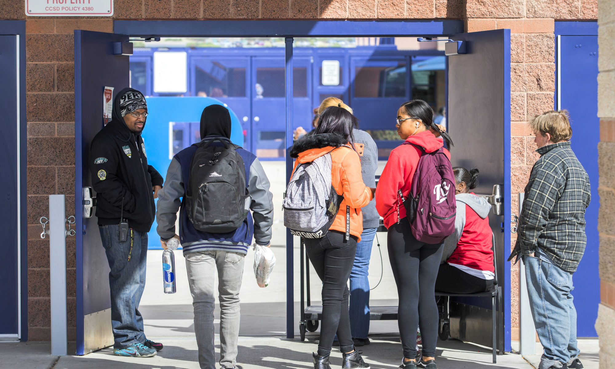 Students walking through a school security checkpoint