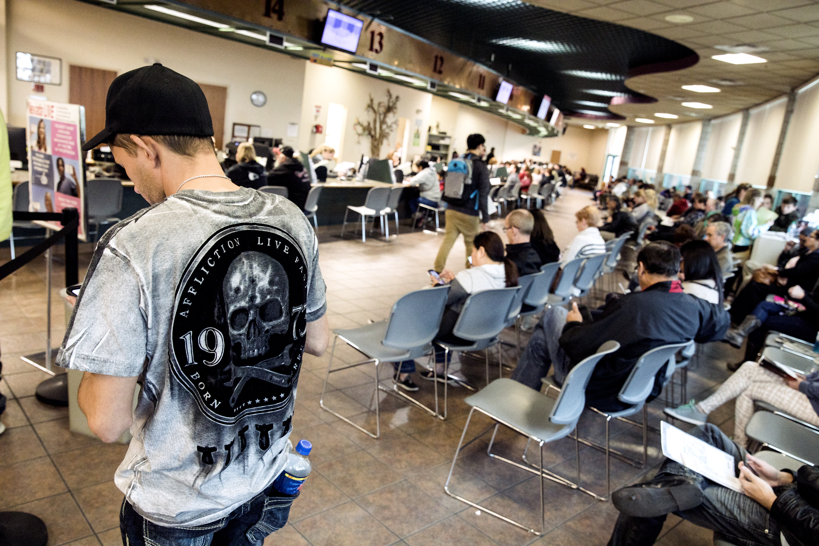 People wait at the DMV office in Henderson on Tuesday, Jan. 2, 2018