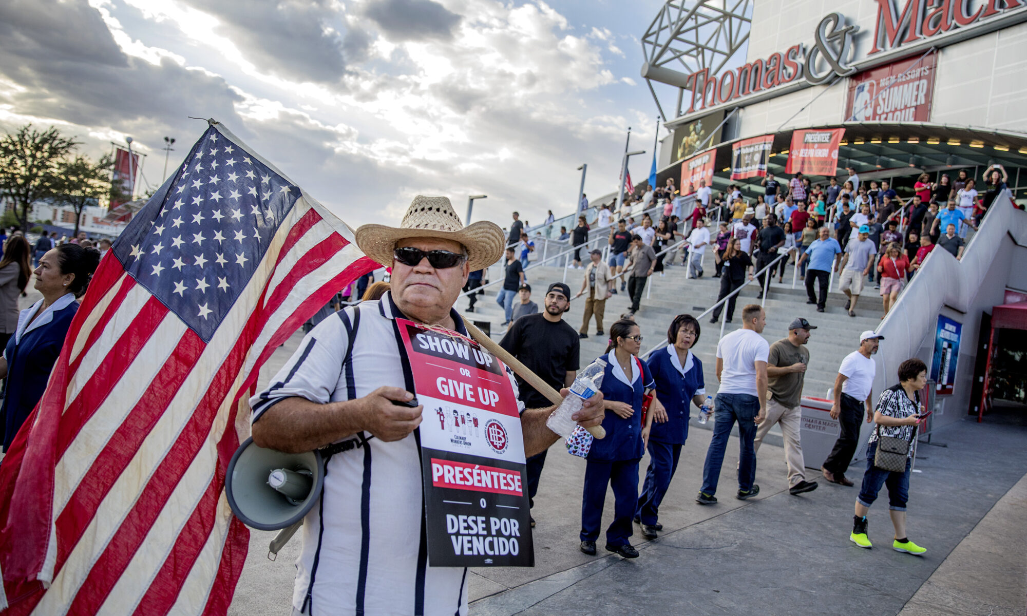 Union member stands holding flag