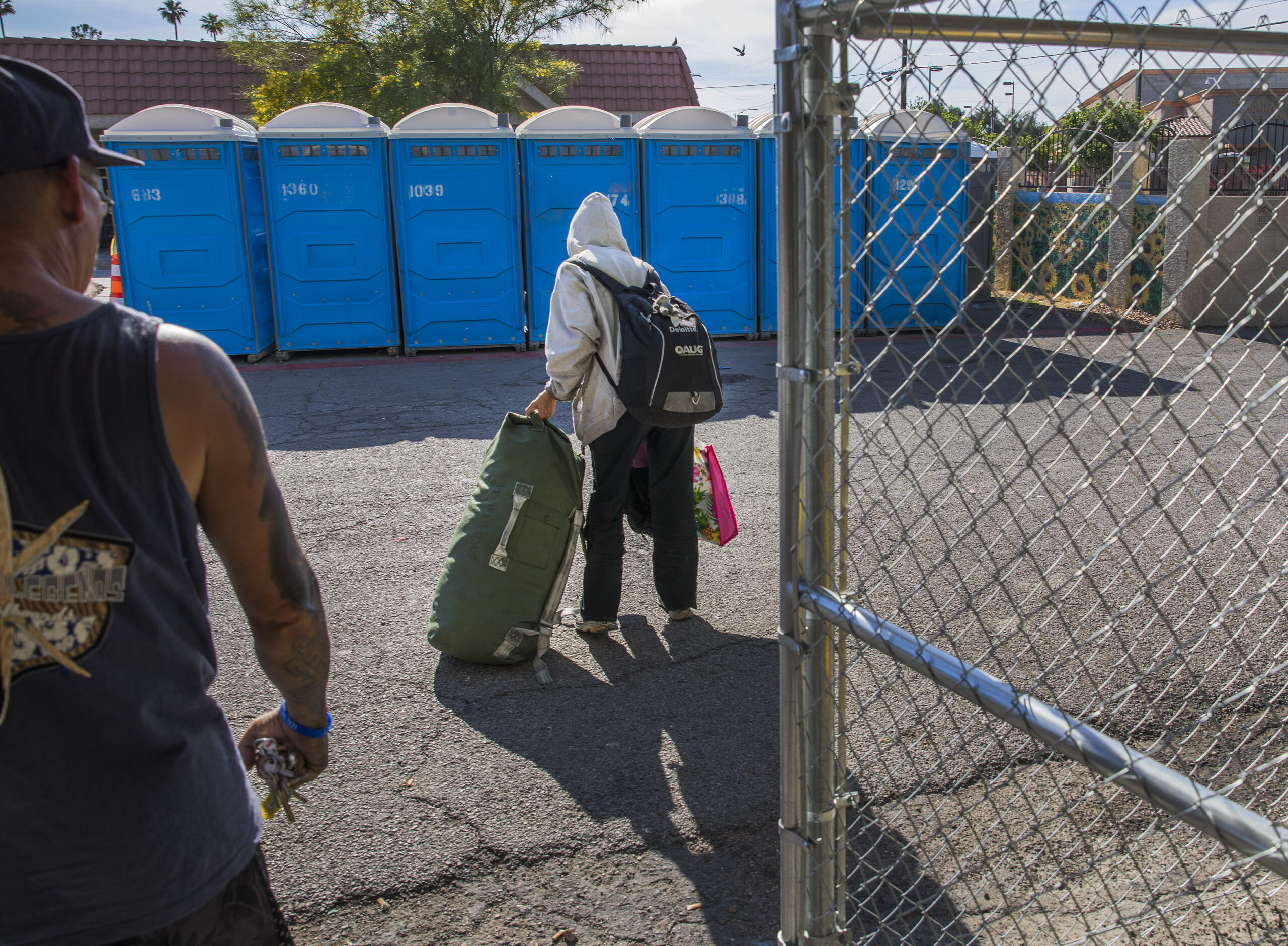 A woman carries her belongings at The Courtyard, a city of Las Vegas operated day shelter for homeless