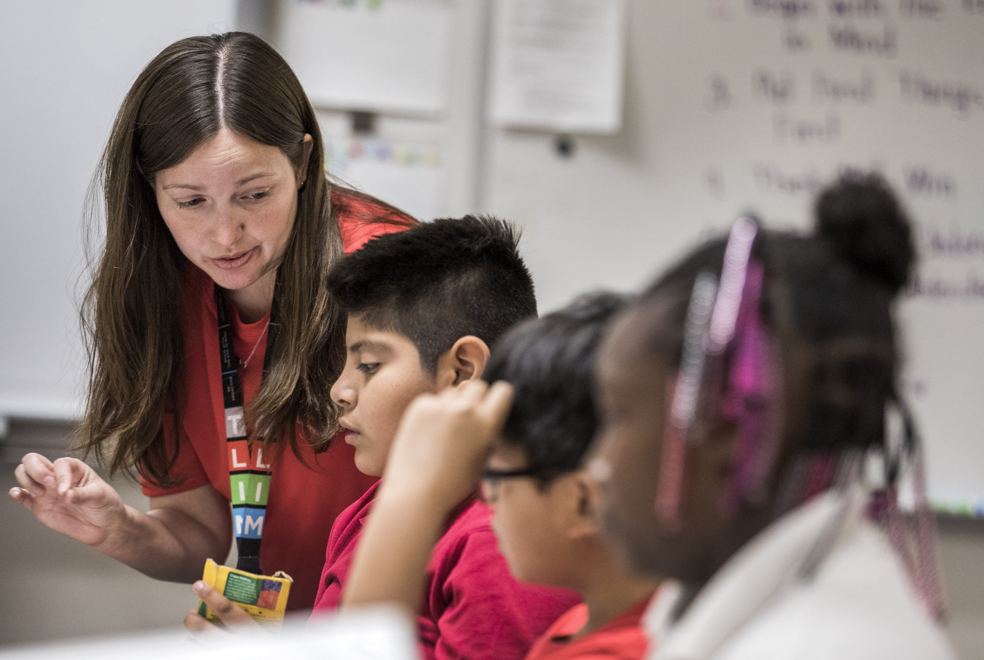 Melissa Tanner, A Fourth Grade Teacher, Talks To A Student On