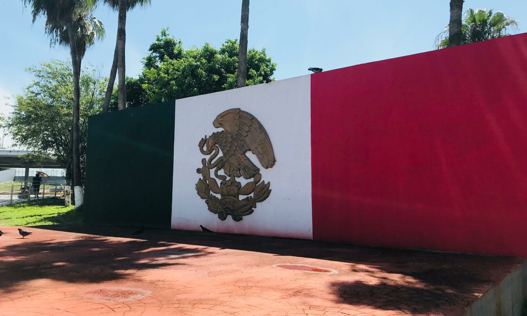 A painted Mexican flag on a wall as seen close to the Tamaulipas Institute for Migrants in Reynosa, Tamaulipas, Mexico