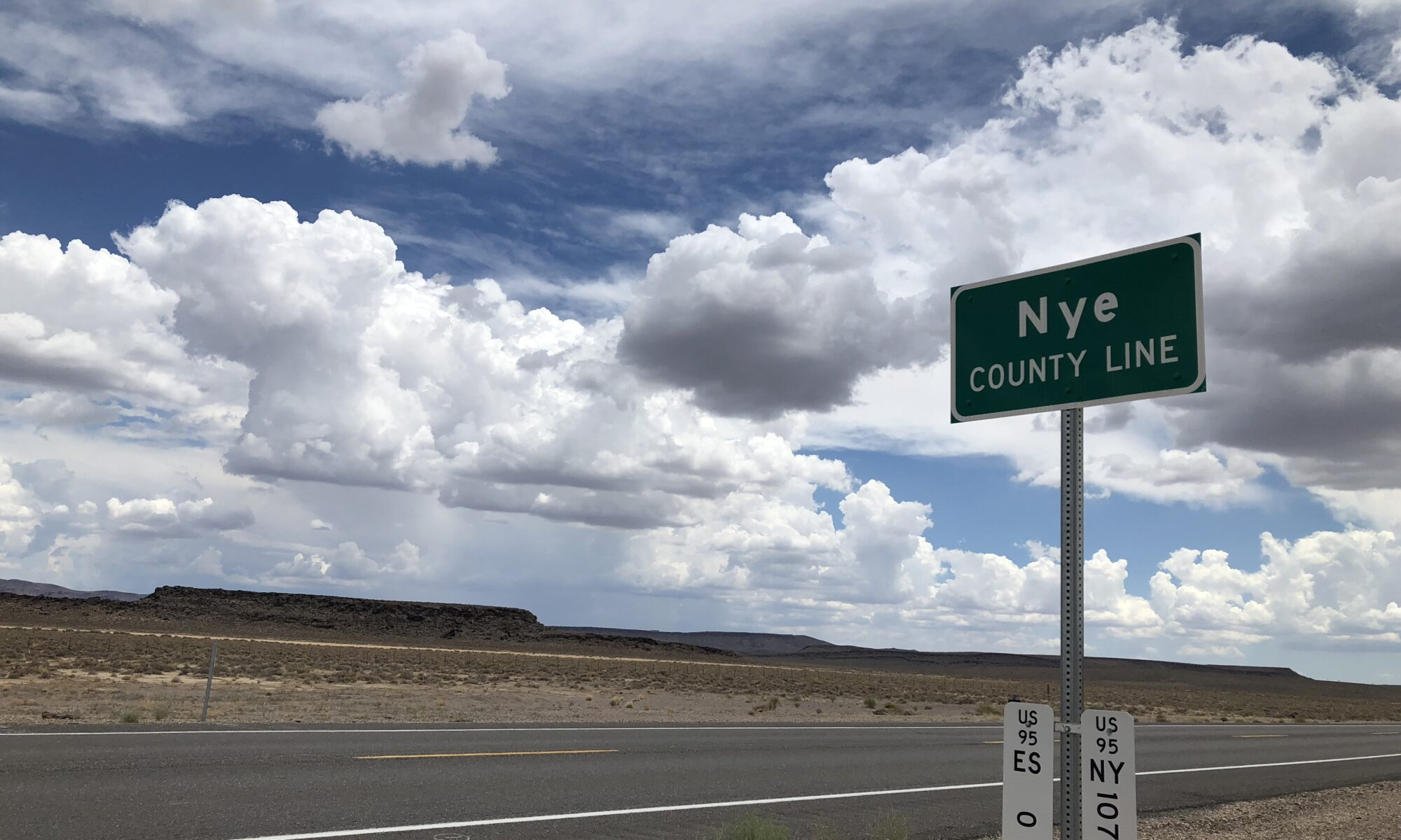 A photo of the sign next to the road entering Nye County.