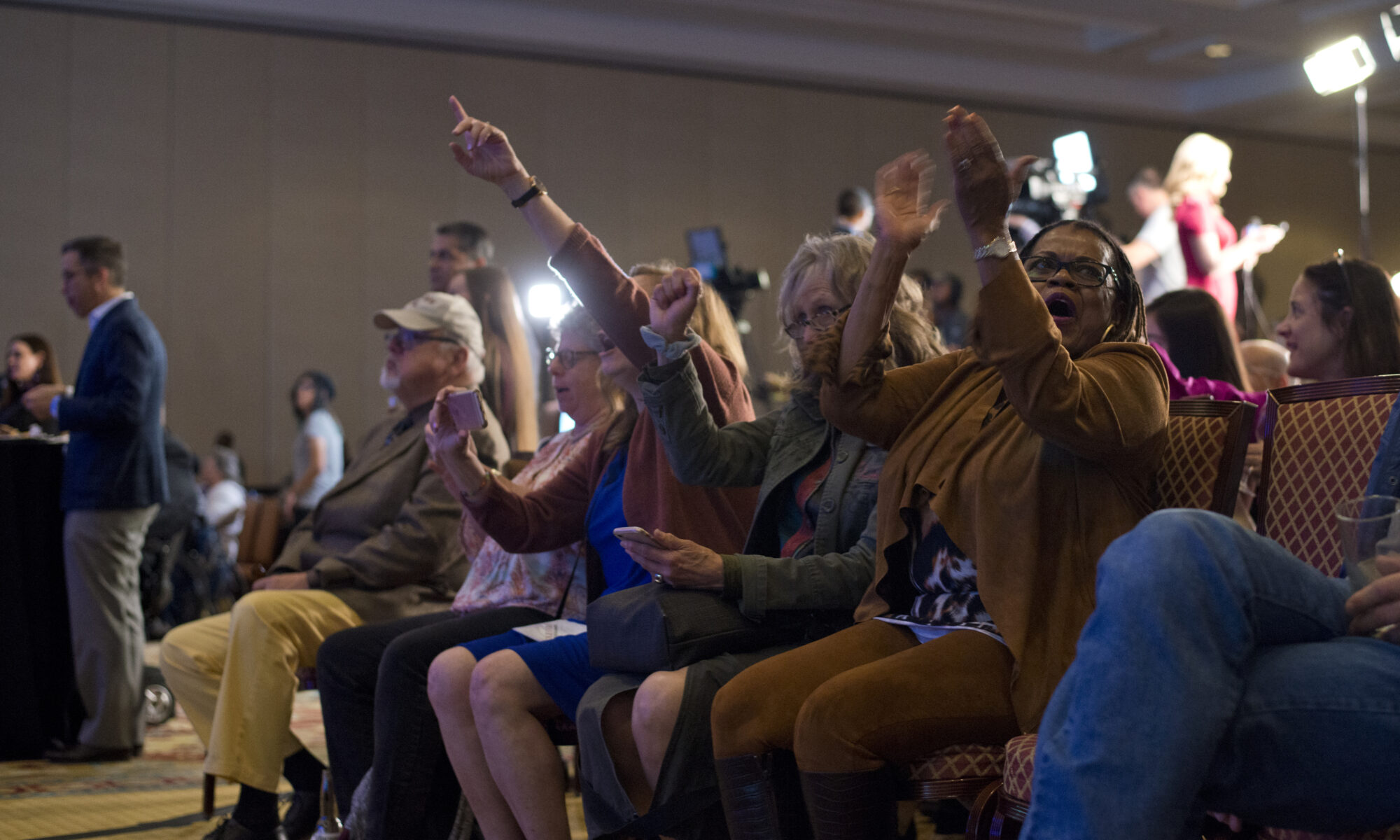 People react after the House is called in favor of Democrats during the Nevada Democratic Party election night event at Caesar Palace