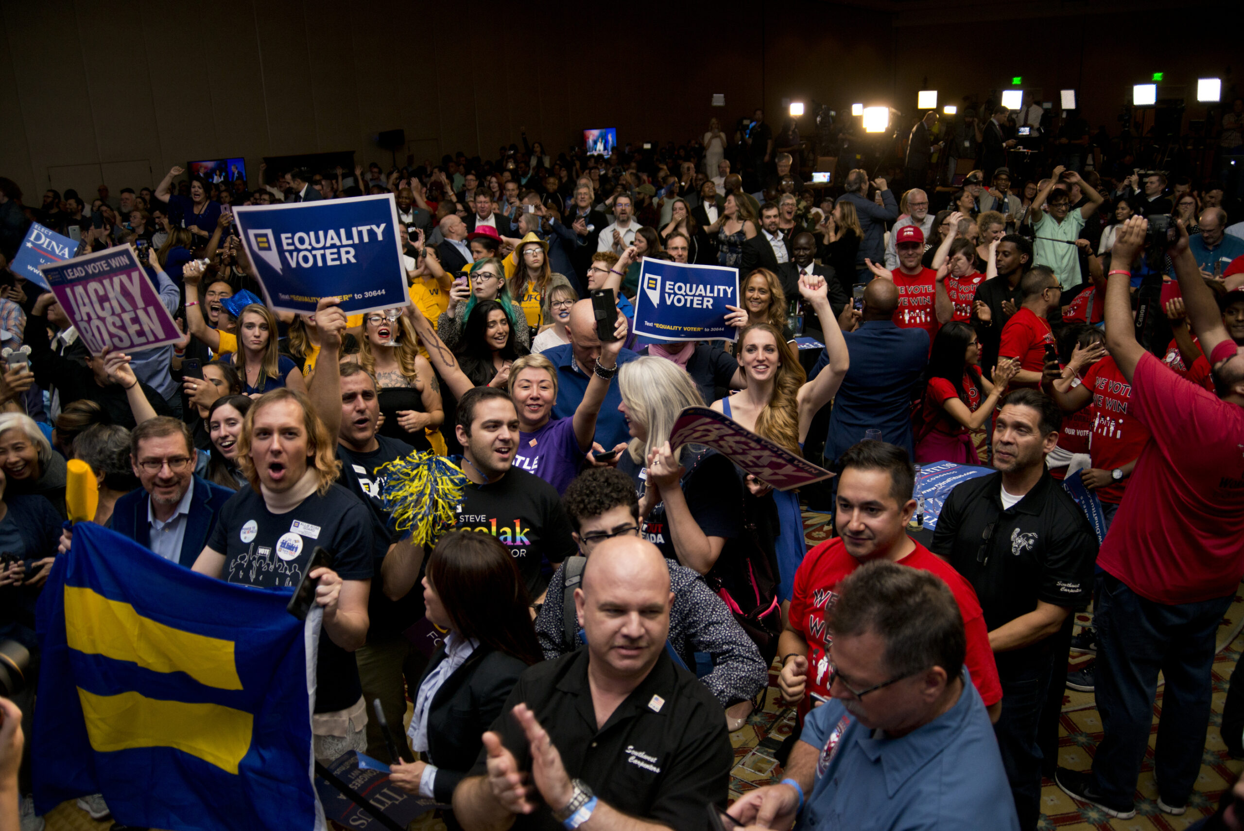 Democratic supporters cheer at the the Nevada Democratic Party election night event at Caesars Palace