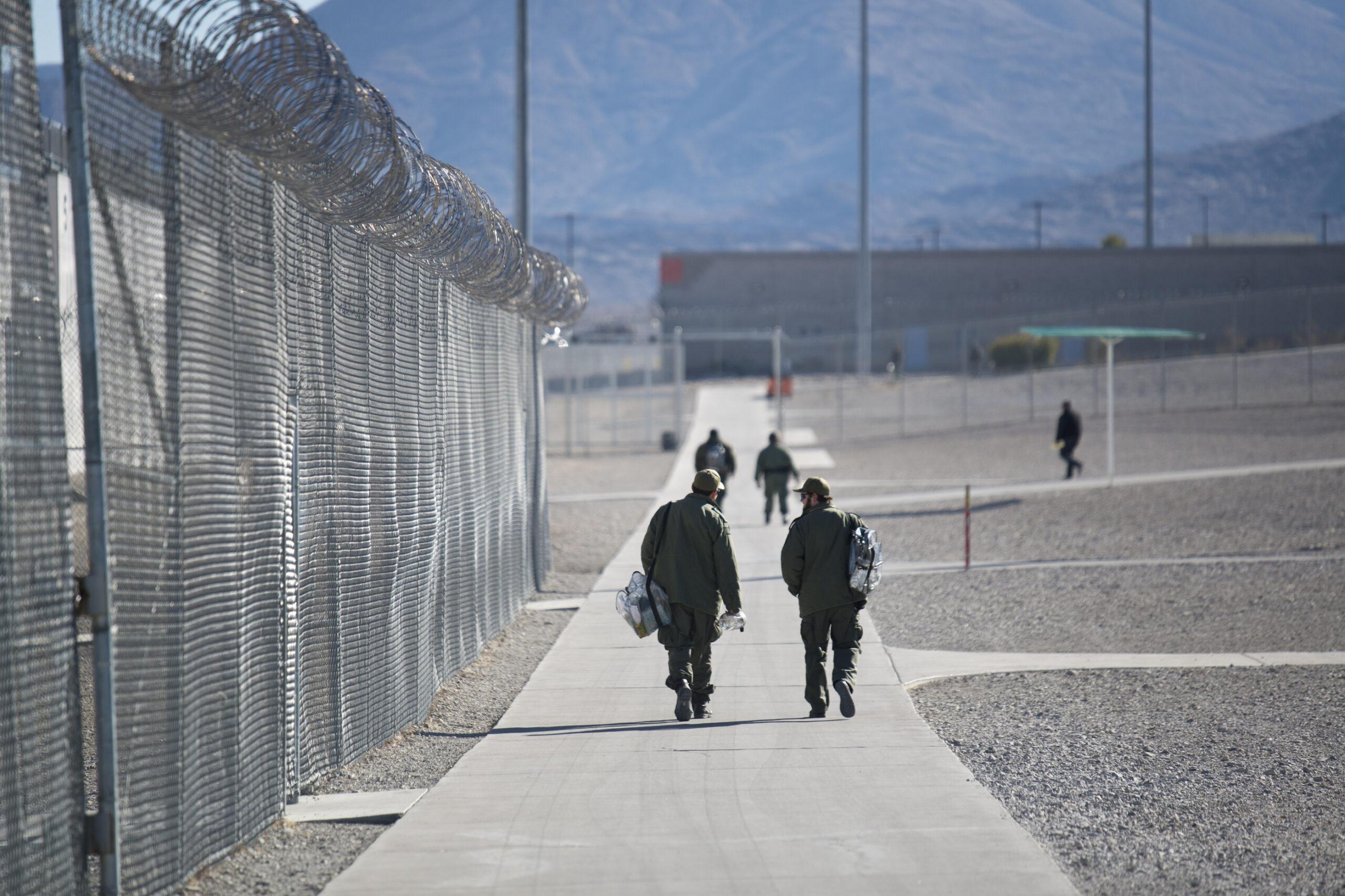 Guards walk inside High Desert State Prison as seen on Friday, Jan. 4, 2019.