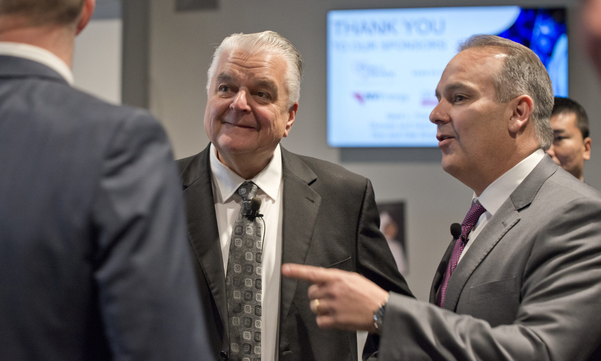 Nevada Governor Steve Sisolak and Clark County Superintendent Jesus Jara speaking with unseen person