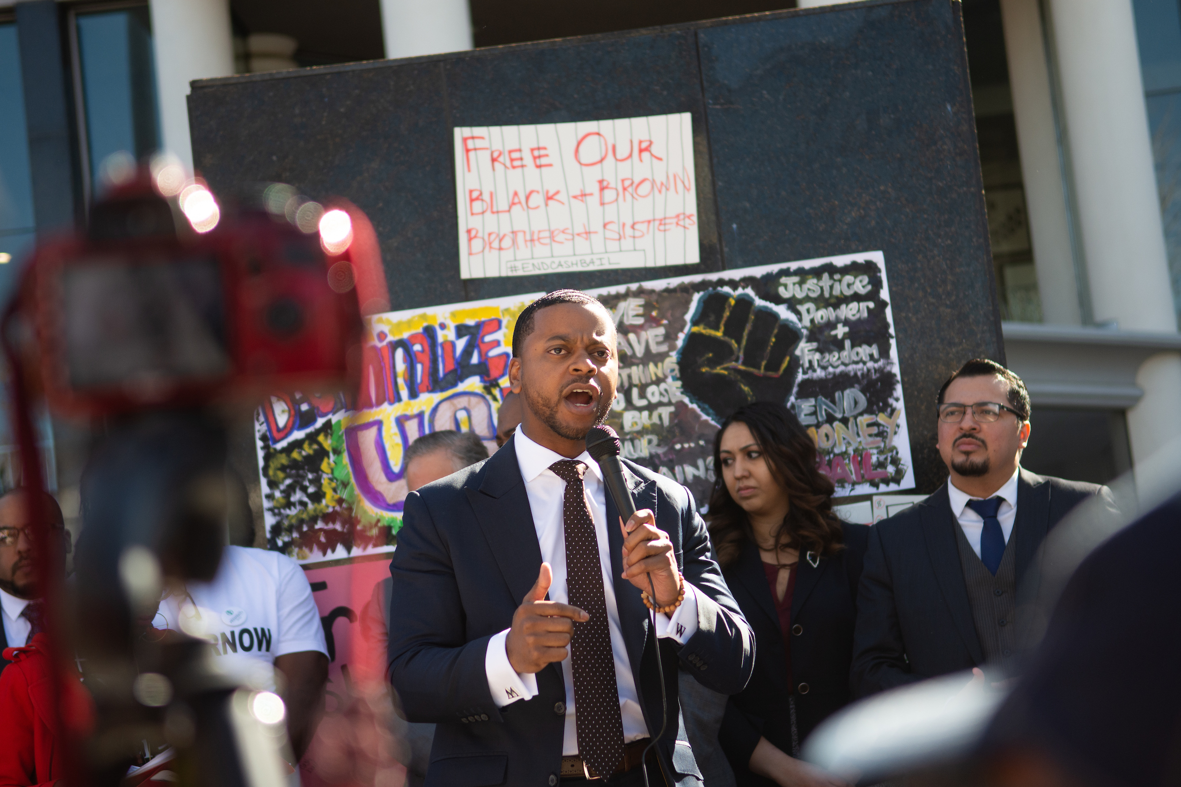 William McCurdy speaking into a microphone during a protest against cash bail outside of the Nevada Legislature