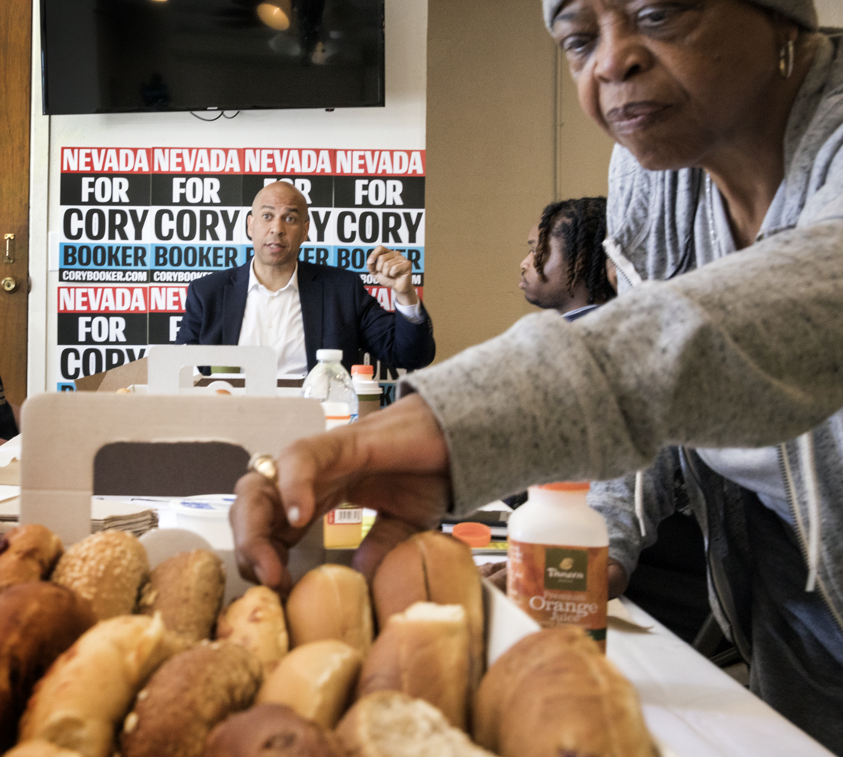 Bagels, church and campaigning: Community members bring focus back to everyday issues during Booker visit