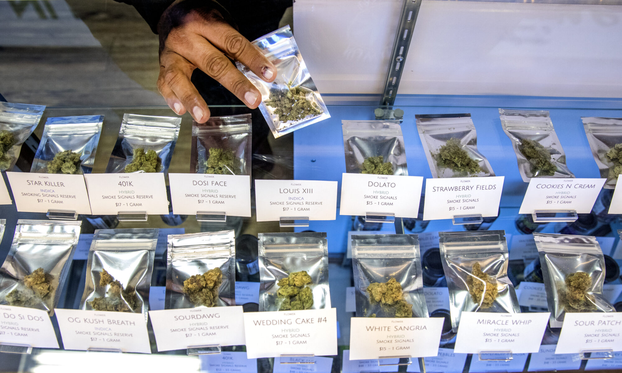 A table of packaged marijuana for sale