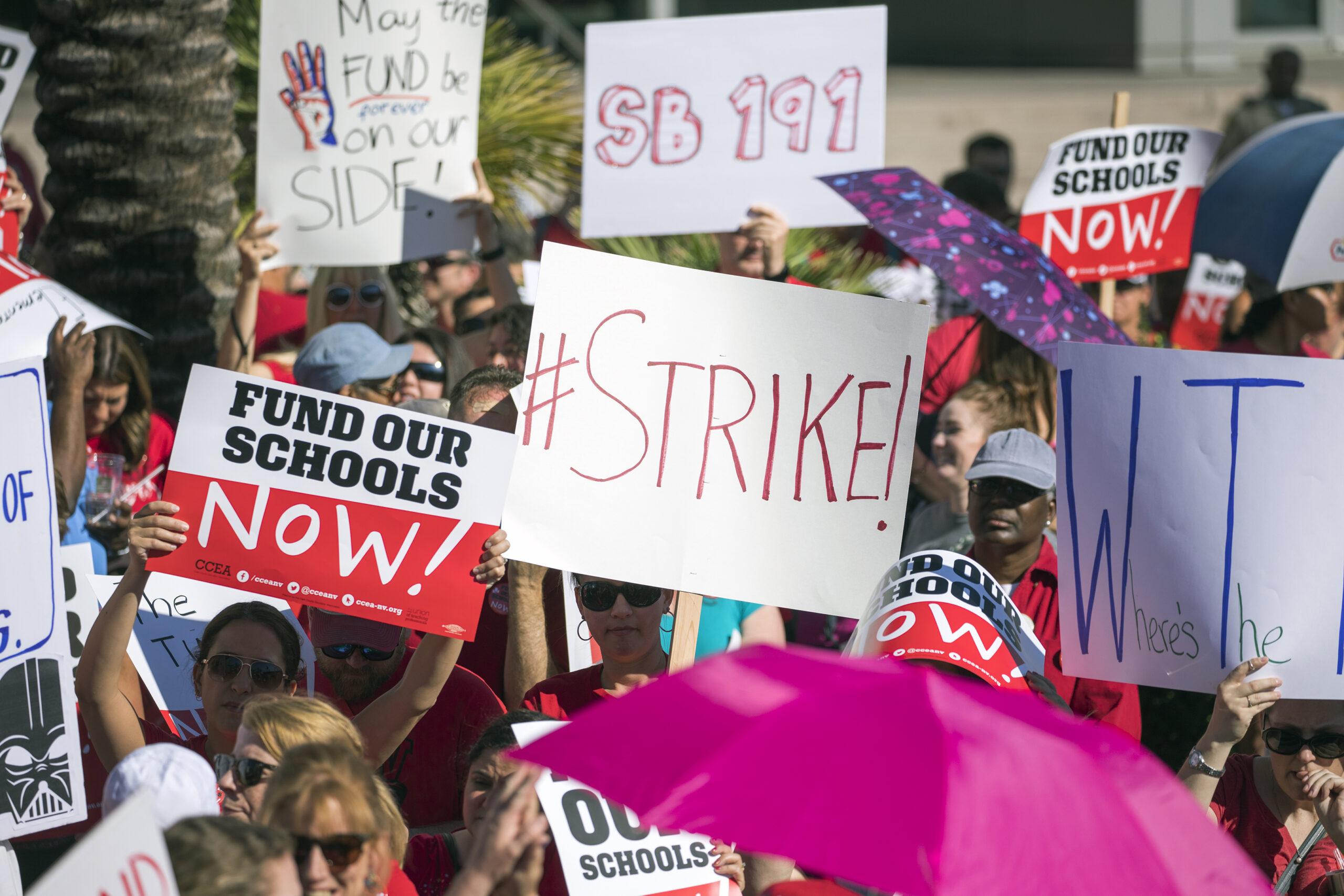 Signs calling for teacher strike