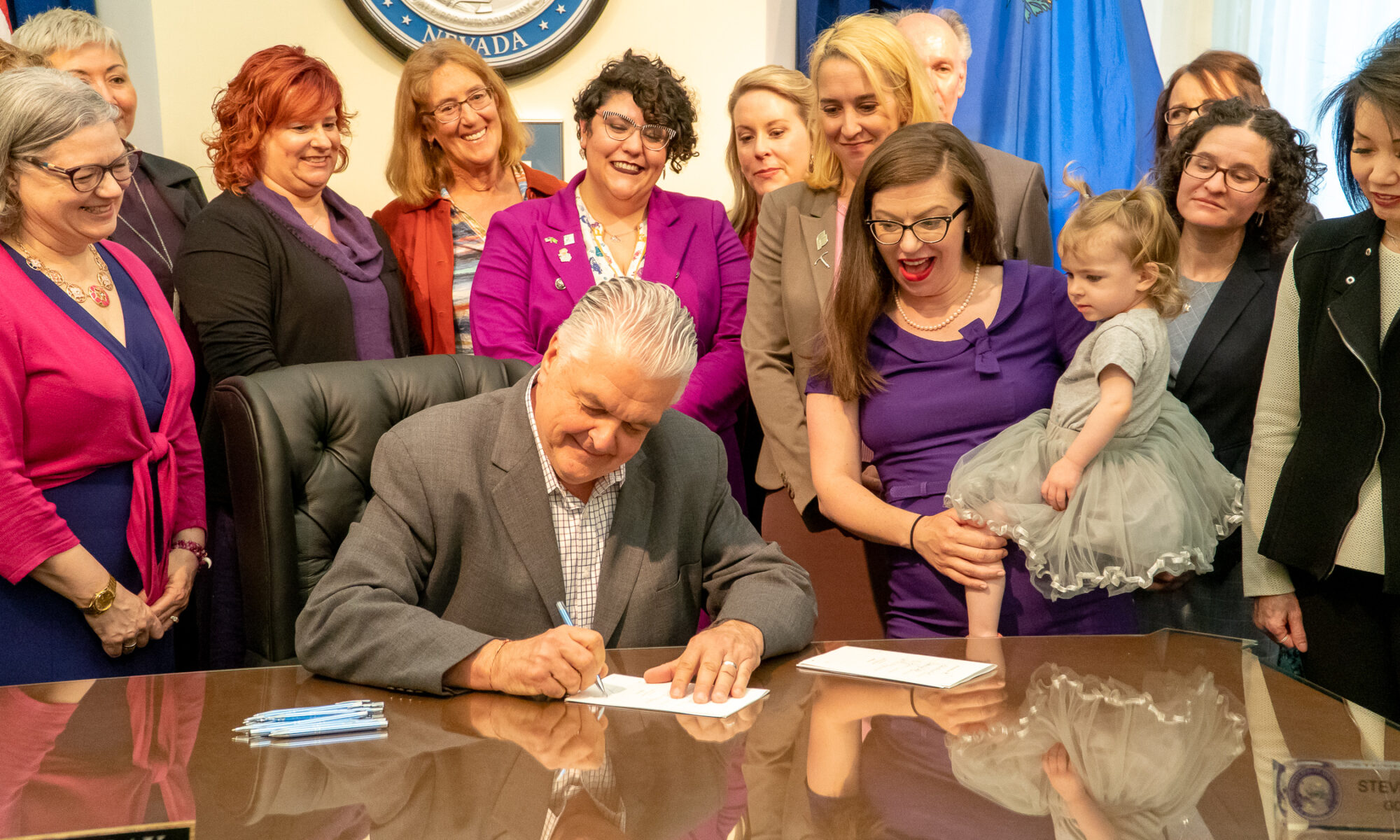 Gov. Steve Sisolak with members of pro-abortion rights groups Planned Parenthood and NARAL Pro-Choice America signing SB179, the Trust Nevada Women Act and SB94, a family planning bill.