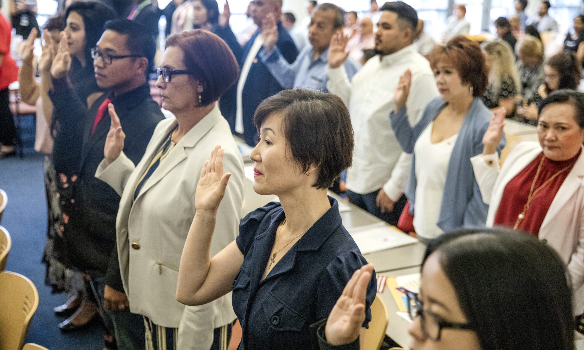 Immigrants from around the globe celebrate first