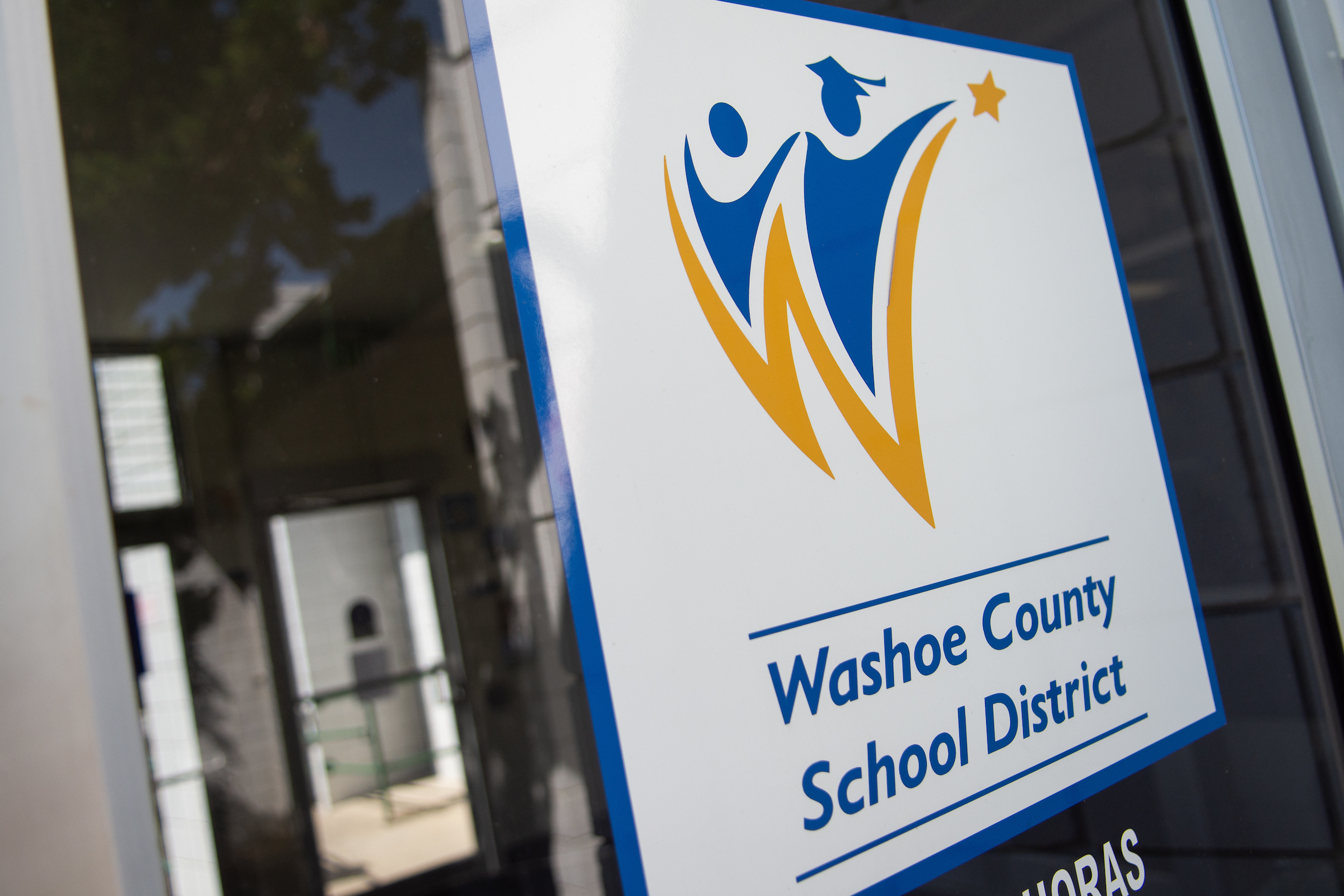 The Washoe County School District's logo as seen on an office building
