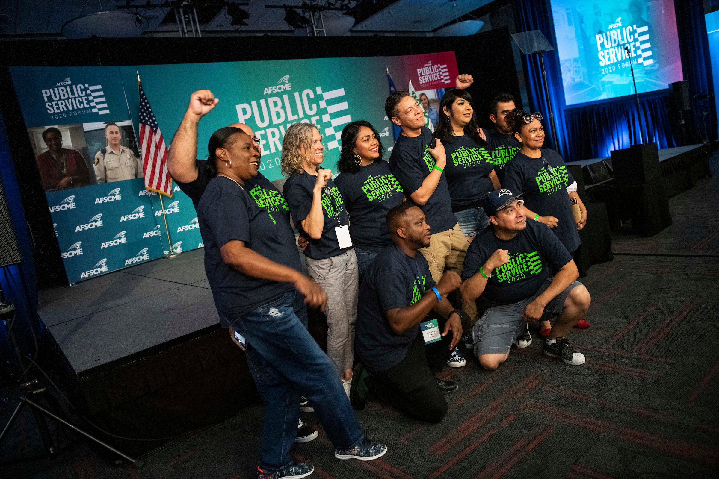 Audience members posing for a photo before the AFSCME Public Service Forum