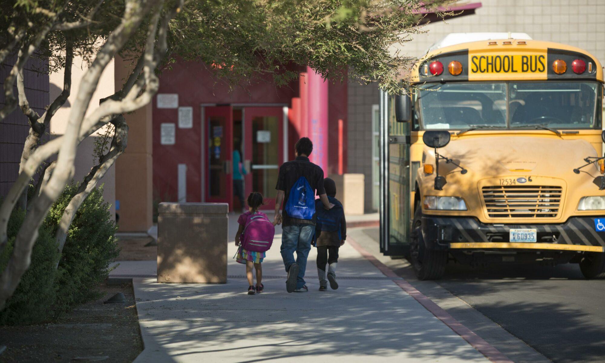 Students walk into J.E. Manch Elementary School in Las Vegas