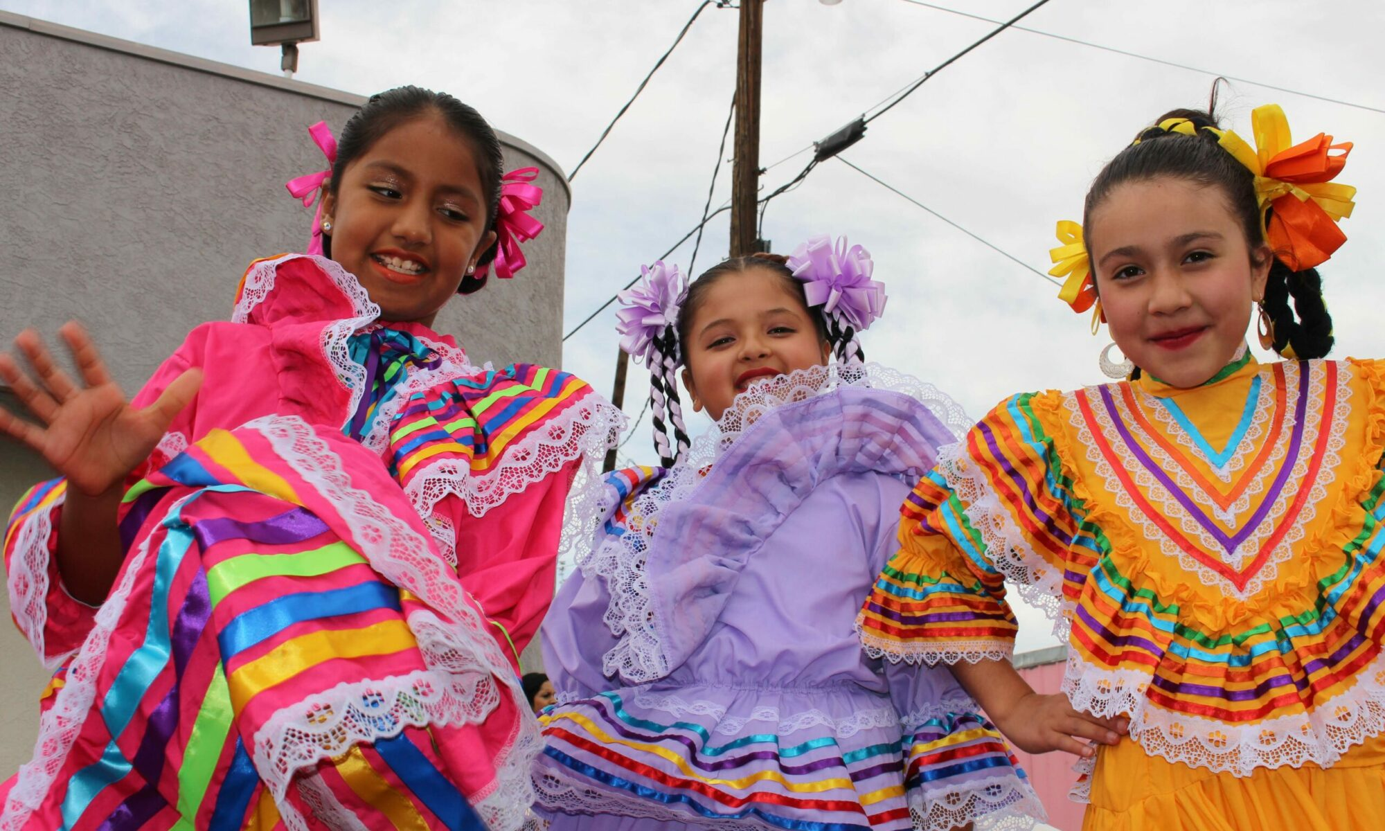 Three young girls after their performance of ballet folklorico at a Reno event celebrating Mexico's Independence Day