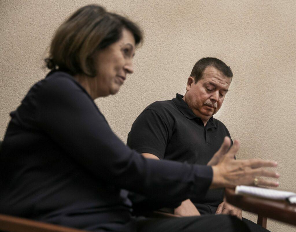 Immigration attorney Eva Garcia- Mendoza, with her client Mario Escobedo
