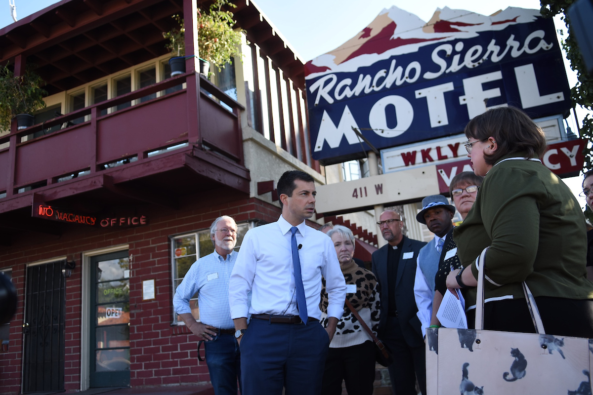South Bend Mayor Pete Buttigieg tours the weekly motels in Downtown Reno