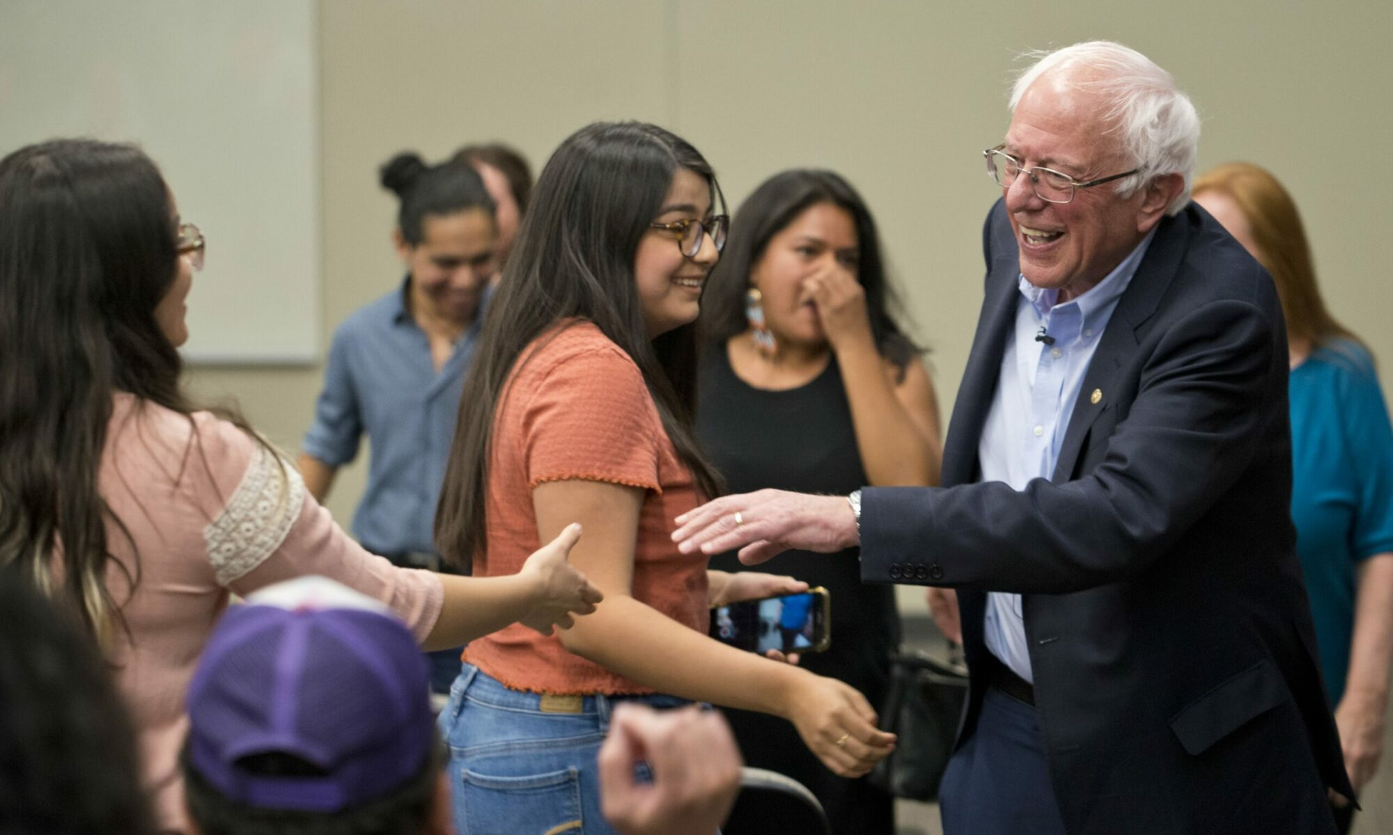 Democratic presidential candidate Sen. Bernie Sanders greets a supporter at a Mijente's El Chisme 2020 event at UNLV in Las Vegas