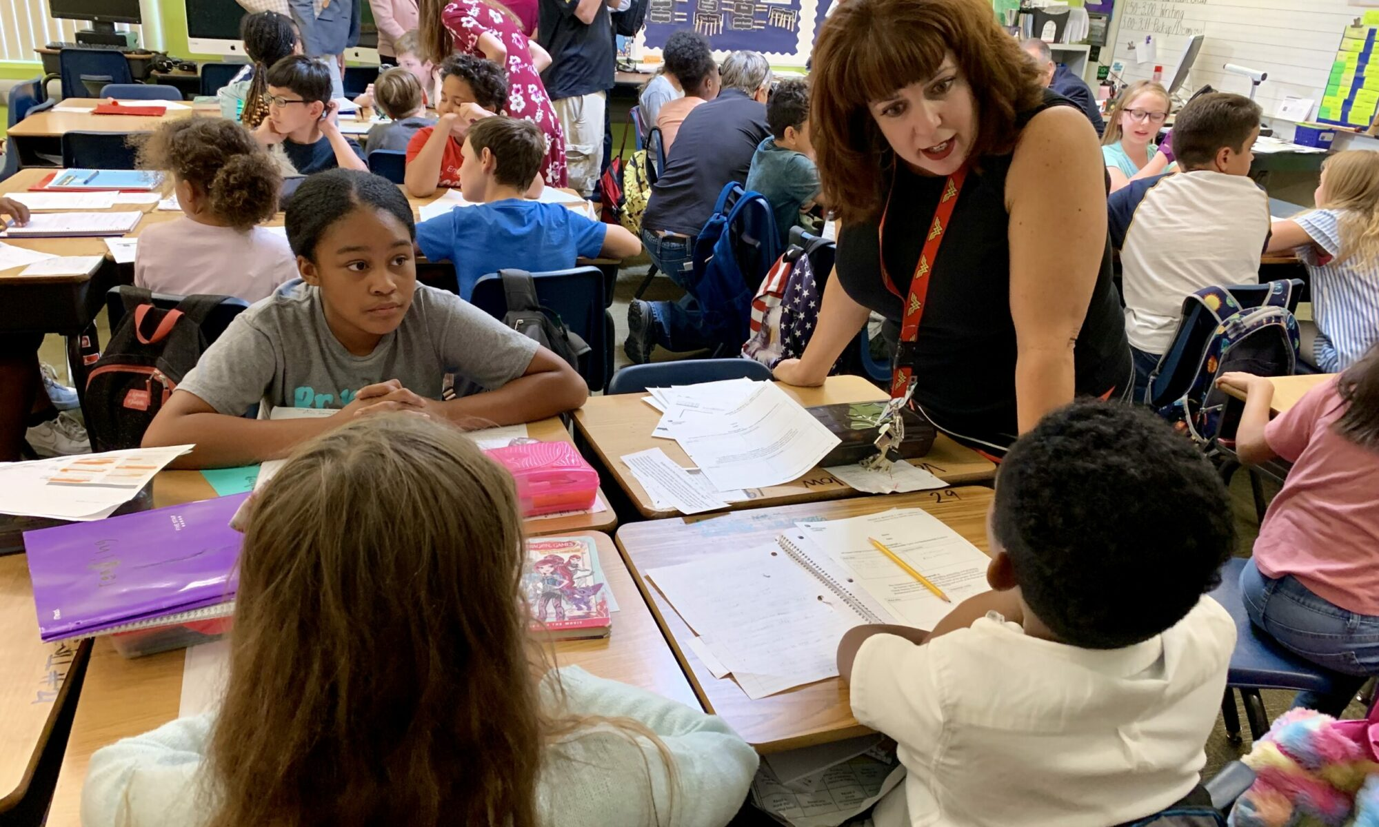 Fifth-grade teacher MaryAnn Thomson talks with her students
