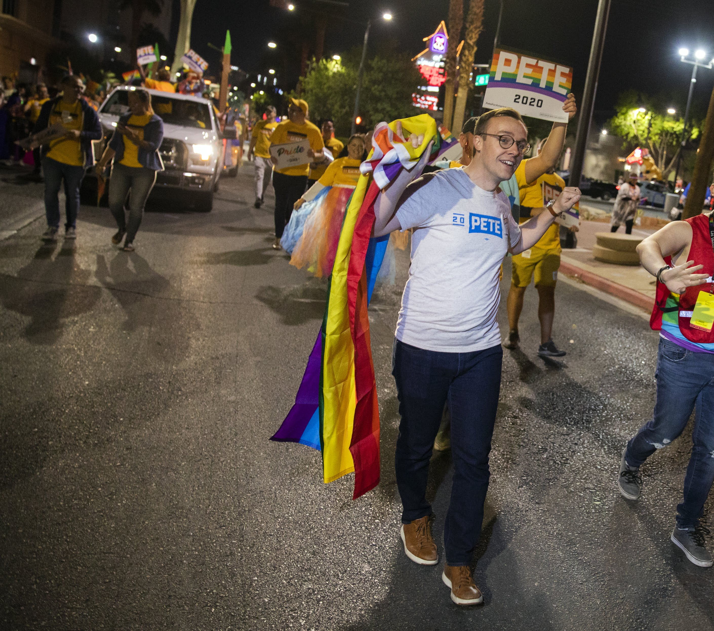 Warren, in a feather boa, dances her way through Las Vegas Pride; surrogates march for other presidential hopefuls