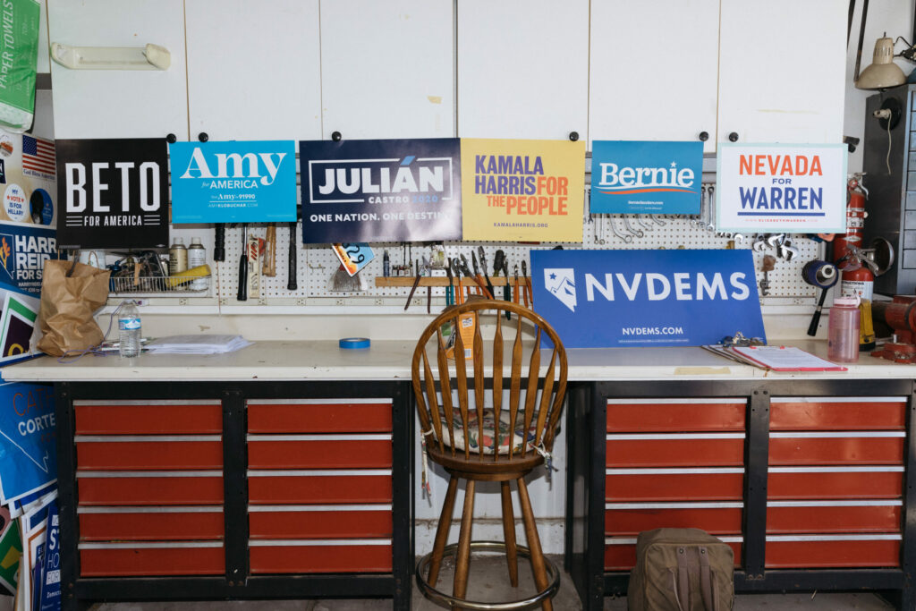A desk and chair with Democratic party signs sitting on top.