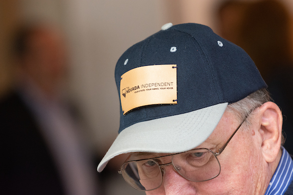 A gentleman and his baseball hat with The Nevada Independent patch on it