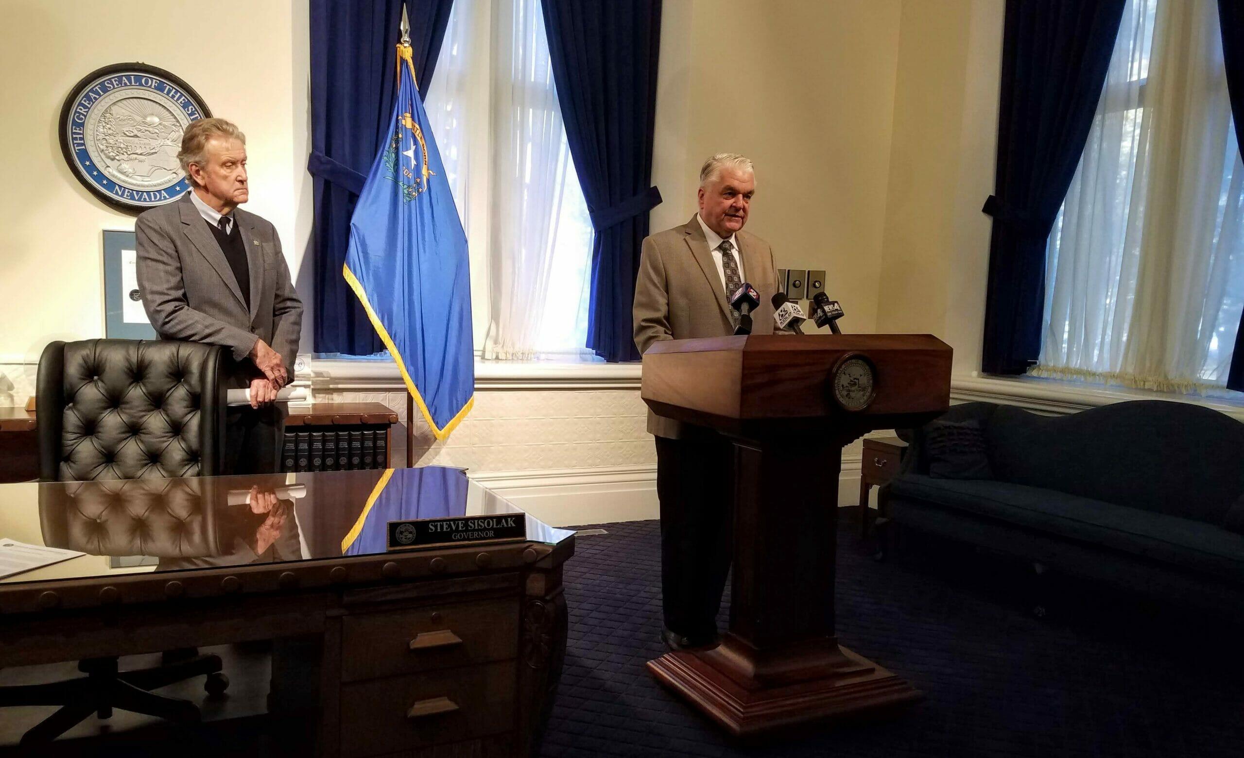 Gov. Steve Sisolak standing in his office