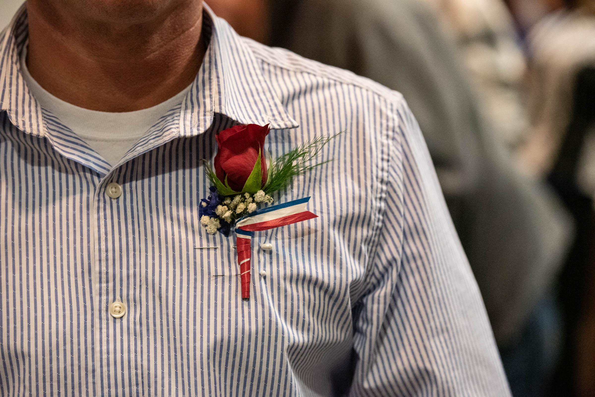 Veterans court graduate wears boutonniere