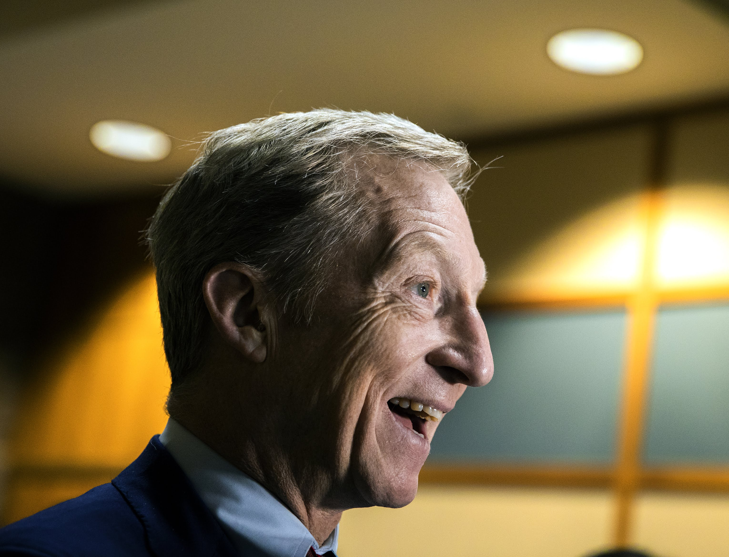 Tom Steyer talks to reporters