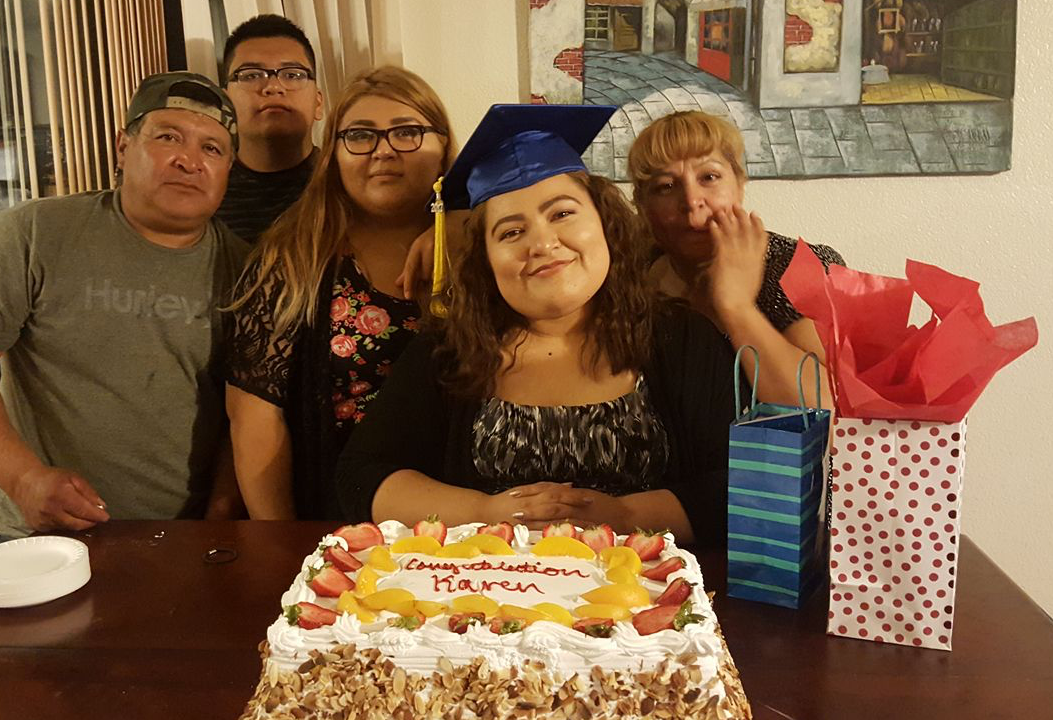 Martinez family with congratulations cake