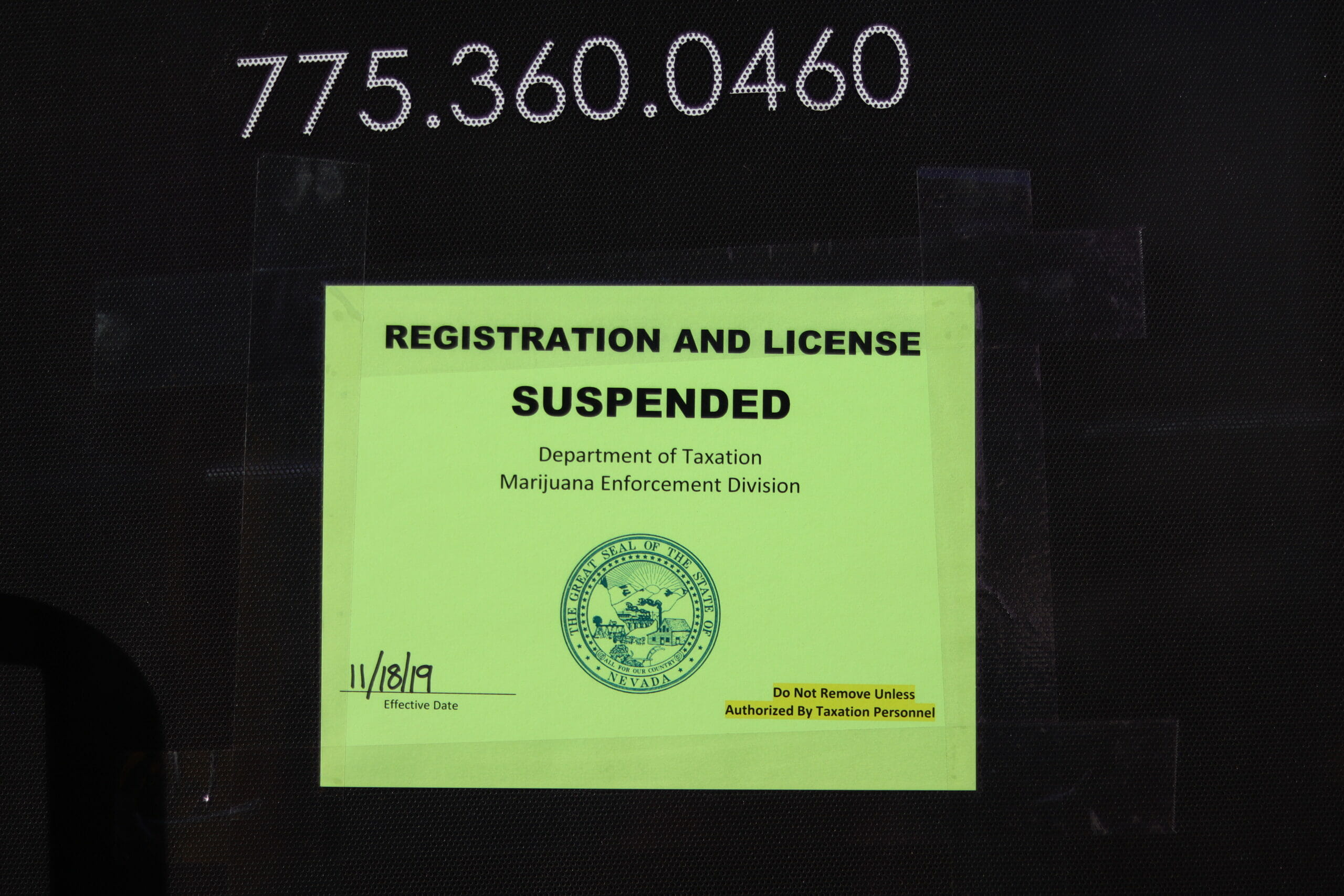 A sign saying registration and license suspended