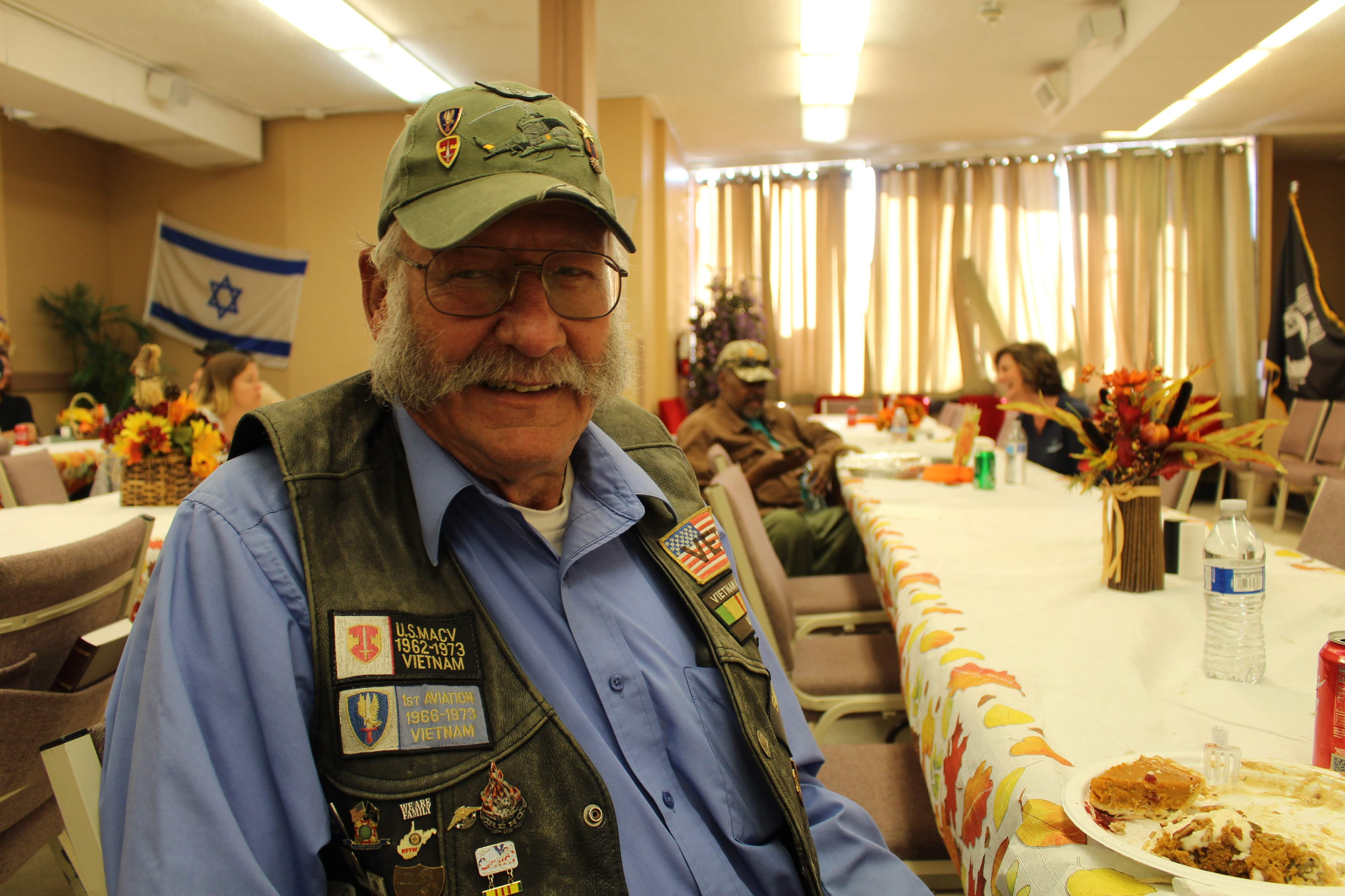 Ed Leffler wearing veteran patches