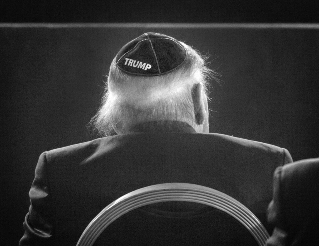 A black and white photo of a yarmulke with the name Trump on it