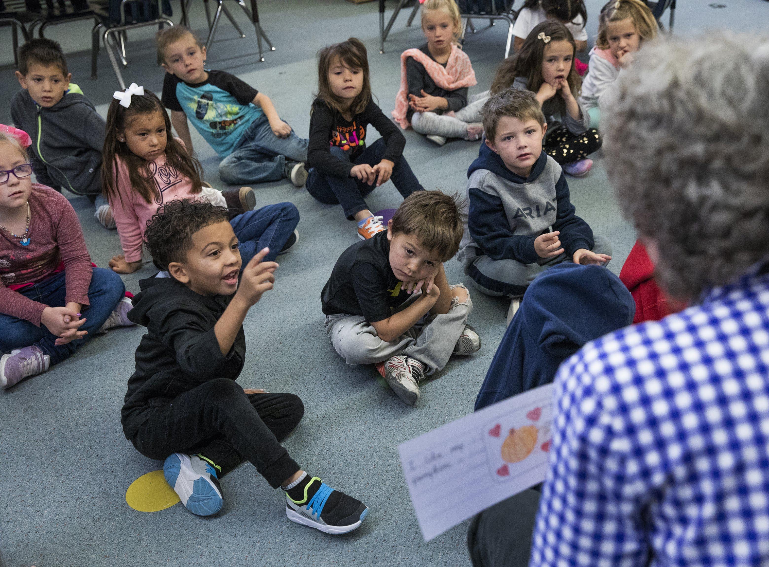 Kindergarten teacher Jody Crampton reads aloud to her students in David E. Norman Elementary School