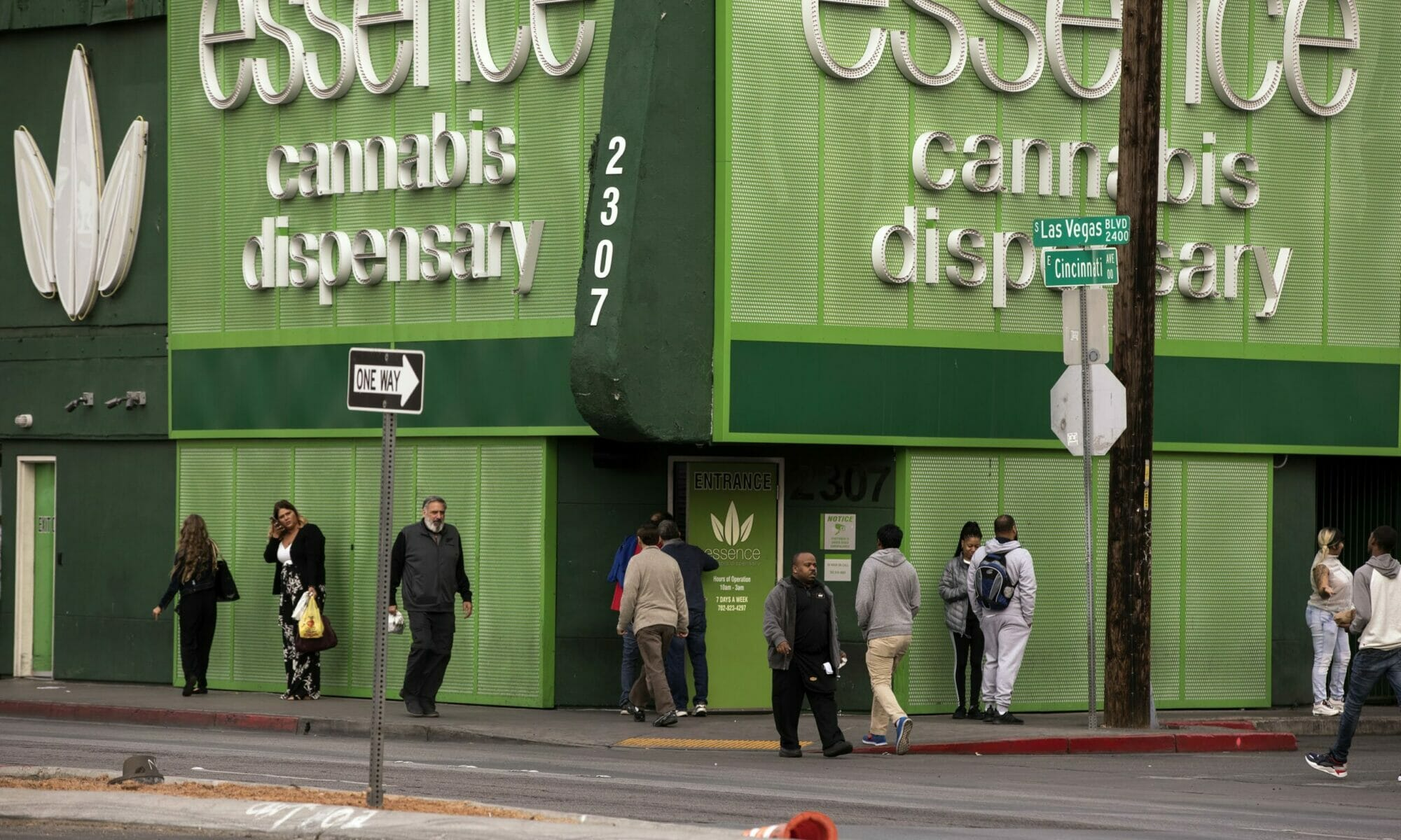 Group of pedestrians outside Essence Cannabis Dispensary