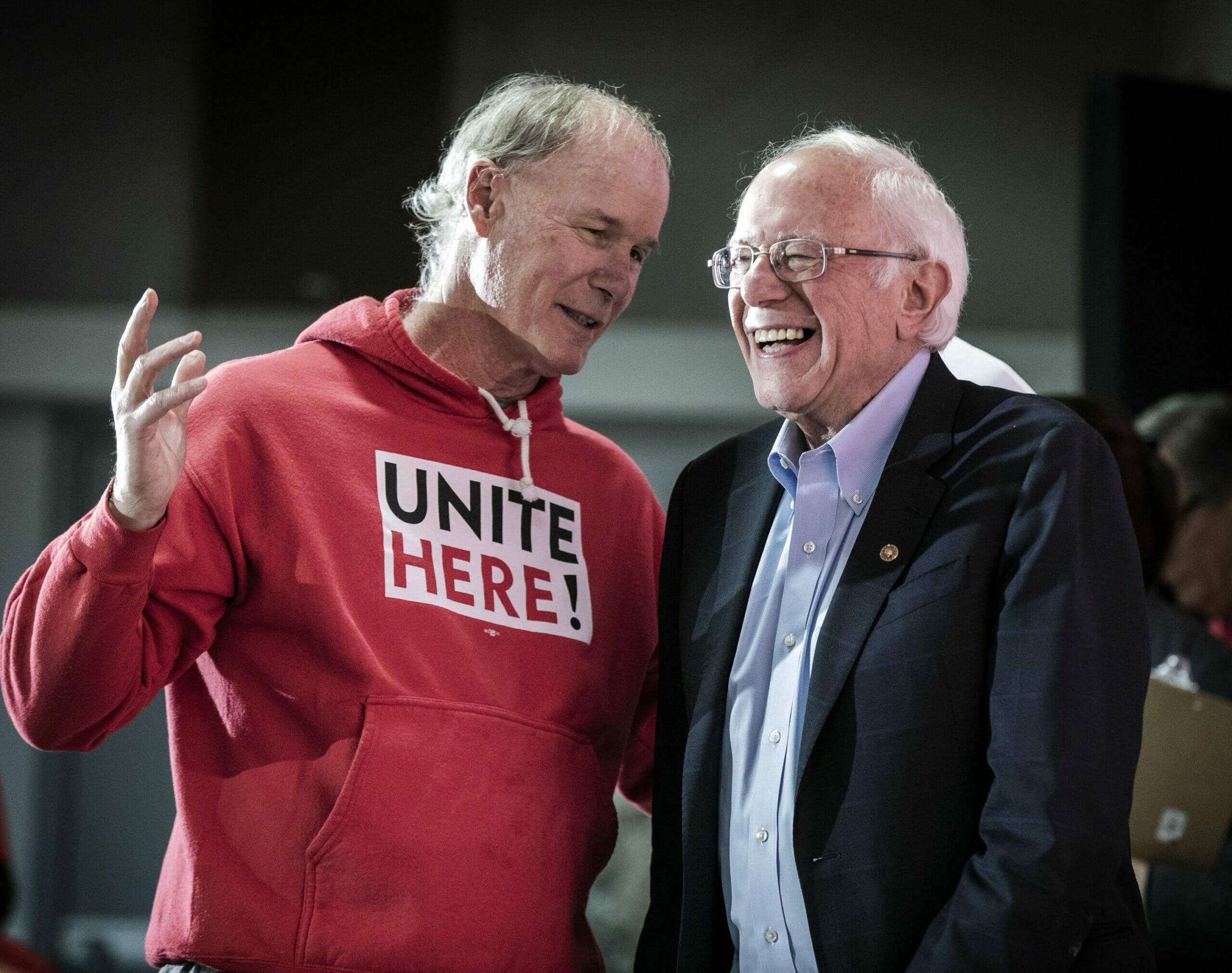 D. Taylor in a red Unite Here sweatshirt with Bernie Sanders in a dark suit jacket