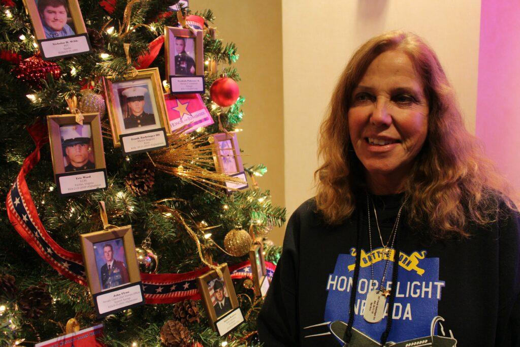 Sharon Zaehringer next to Christmas tree