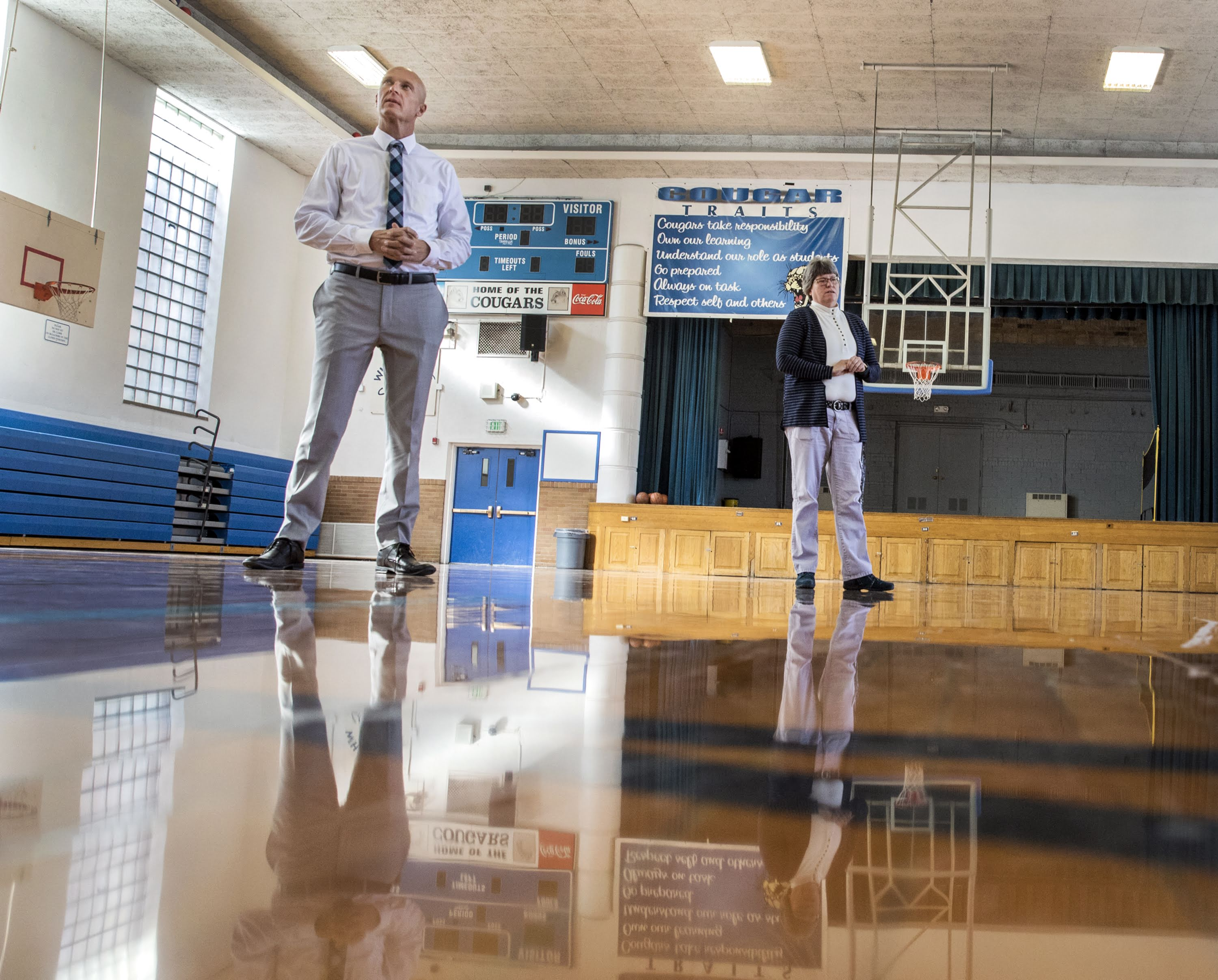 White Pine County School District Superintendent Adam Young, left, and Principal Susan Jensen talk about the condition of the gymnasium floor inside White Pine Middle School