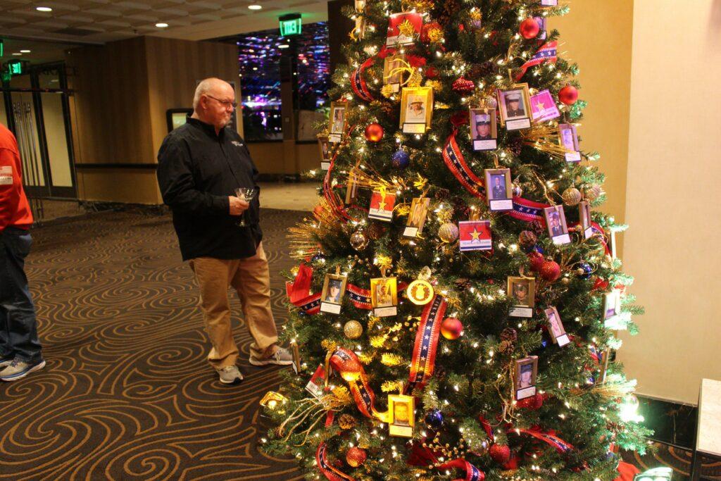 Man looks at Christmas tree