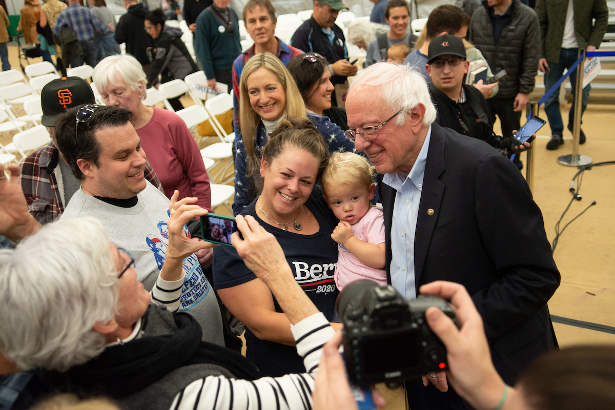Bernie Sanders poses with fans