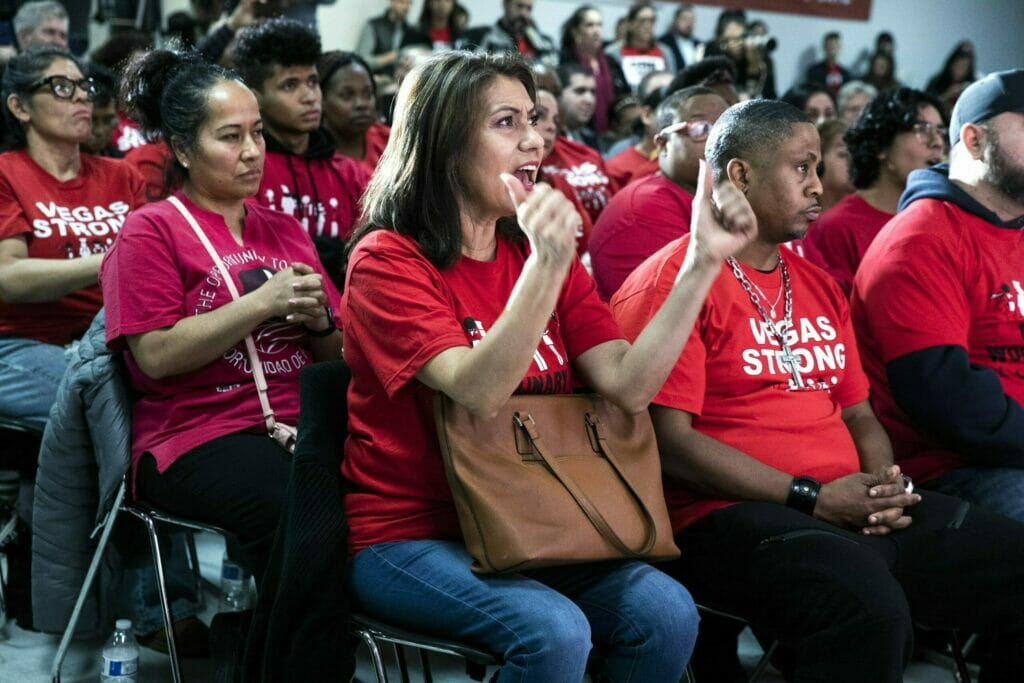 The attendees at a Culinary Union event all wearing red shirts