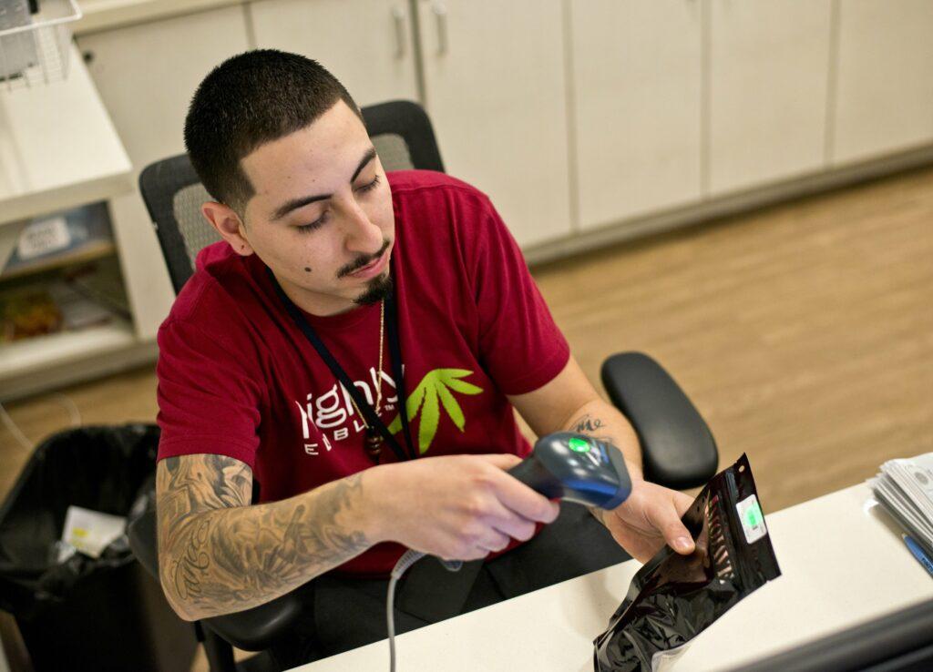 Clerk scanning marijuana barcode