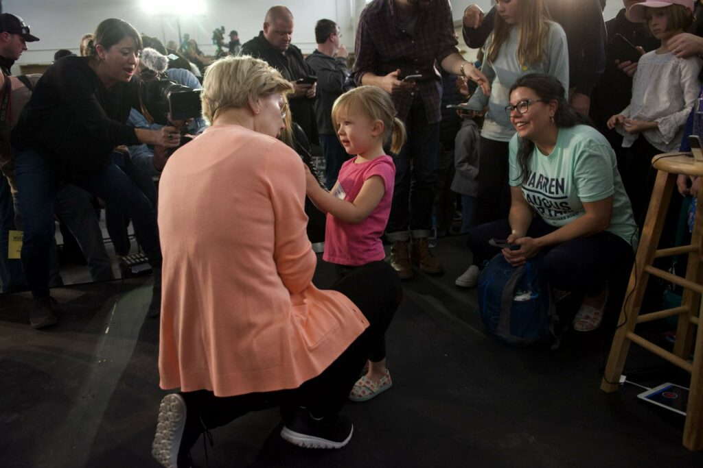 Elizabeth Warren talks with child